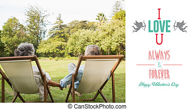 Composite image of happy mature couple sitting in park -...