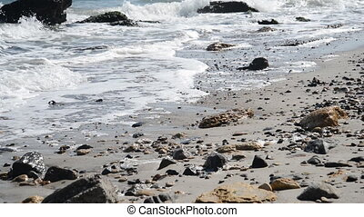 Sea cost with waves, sand and stones
