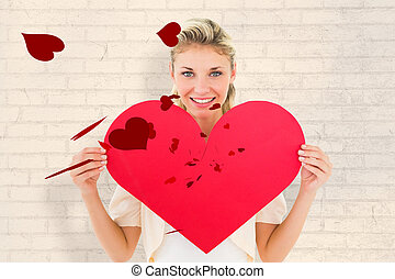 Composite image of attractive young blonde showing red heart...
