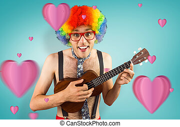 Composite image of geeky hipster in afro rainbow wig playing...