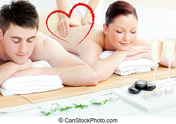 Composite image of charming young couple enjoying a back...