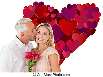 Composite image of affectionate man kissing his wife on the...
