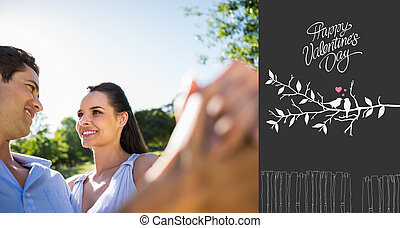 Composite image of loving and happy couple dancing at park -...