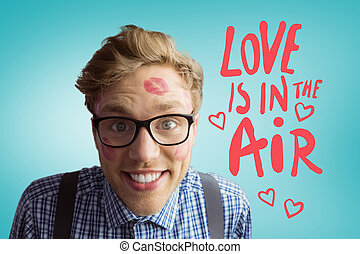 Composite image of geeky hipster covered in kisses - Geeky...