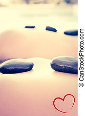 Composite image of couple getting hot stone massage - Couple...