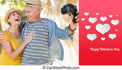 Composite image of happy tourist couple taking a selfie in...
