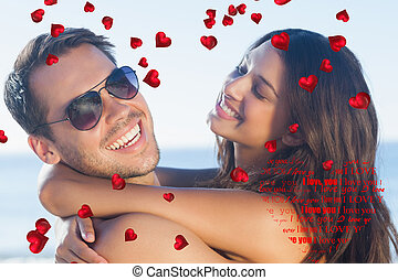 Composite image of cheerful loving couple hugging each other...