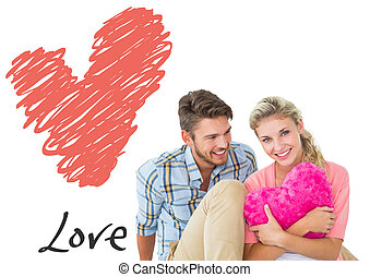 Composite image of attractive young couple sitting holding...
