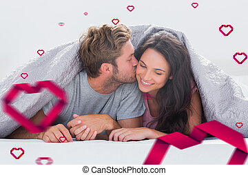 Composite image of attractive man kissing his wife -...