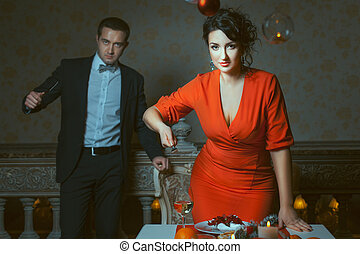 Woman with a fork, the man holding knife - Woman in red...