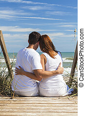 Romantic Man & Woman Couple Sitting Beach Steps
