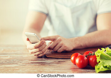 closeup of man pointing finger to smartphone - cooking,...