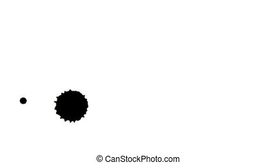 drop black ink blot blob - Ink droplets falling on a white...