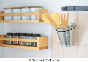 Wooden spatulas and rack with spices - Wooden spatulas in a...