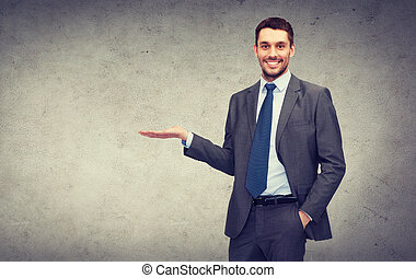 man showing something on the palm of his hand