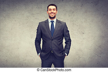 handsome buisnessman - business and office concept -...