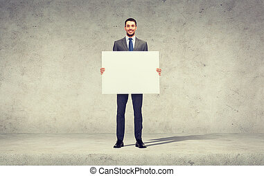 smiling businessman with white blank board - business,...