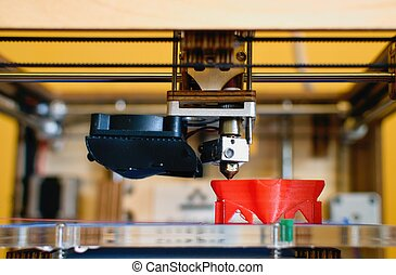 3D printer - Head of 3D printer currently producing an...