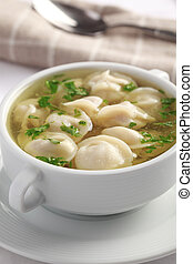 Ravioli with chicken broth - Pelmeni with chicken broth in...
