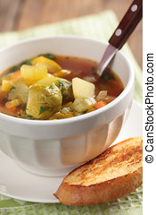 Minestrone in white bowl with toast