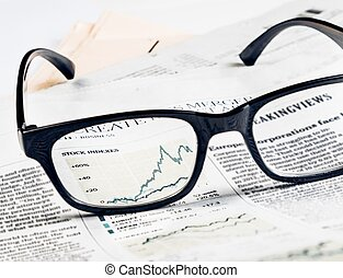 financial chart and graph of stock indexes see through...