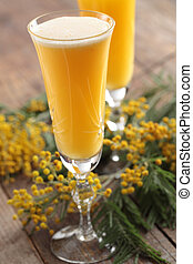 Mimosa cocktail - Two glasses of mimosa cocktail against...