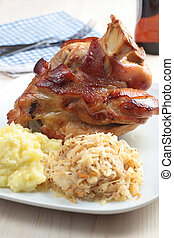 Roasted pork knuckle with mashed potato and braised...