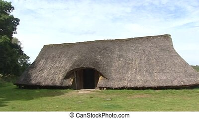 reconstructed Iron Age farm with thatched roof + pan granary...
