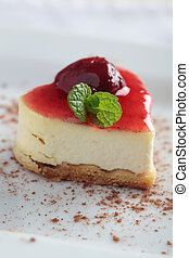 Cheesecake with jam - Heart-shaped slice of cheesecake with...