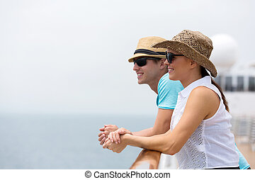 young couple on cruise vacation - lovely young couple on...