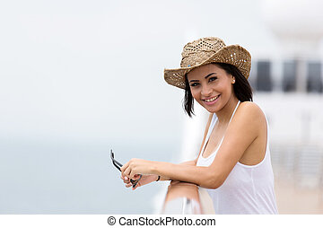 beautiful woman looking at the camera on a cruise