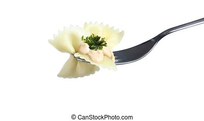 fork of bow pasta butterflies dressed with rose sauce and...