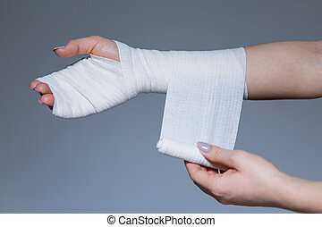 Woman with bandage on the wrist, horizontal
