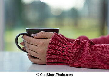 Woman drinking hot tea - Horizontal view of woman drinking...