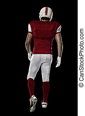 Football Player with a red uniform walking, showing his back...
