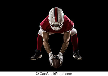 Football Player with a red uniform on the scrimmage line, on...