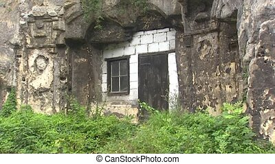 Cave dwellings with limestone blocks facade + pan window -...