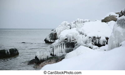Baltic sea coast in winter covered with snow and ice Latvia,...