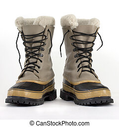 heavy snow boots - a pair of heavy snow boots on white...