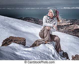 Enjoying winter mountains - Beautiful stylish woman in snowy...