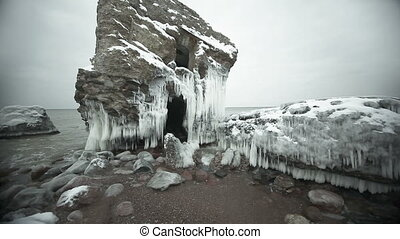 Dramatic frozen demolished forts ruins in Baltic sea,...