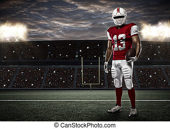 Football Player with a red uniform on a Stadium..