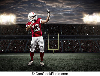 Football Player with a red uniform making a selfie on a...