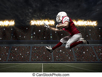 Football Player with a red uniform Running on a stadium