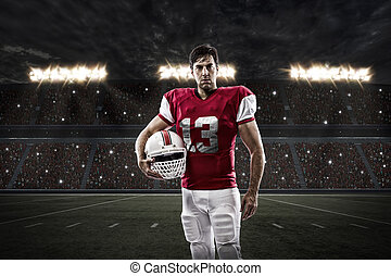 Football Player with a red uniform on a stadium.