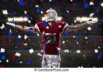 Football Player with a red uniform celebrating, on a stadium...