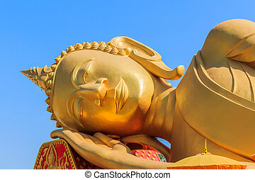 Image of Reclining Golden Buddha face. - Image of Reclining...
