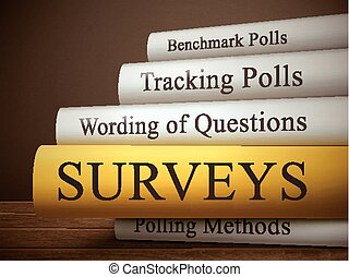 book title of surveys isolated on a wooden table over dark...