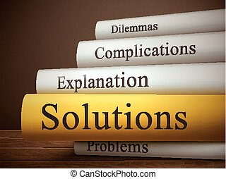 book title of solutions isolated on a wooden table over dark...