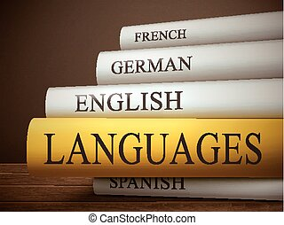 book title of languages isolated on a wooden table over dark...